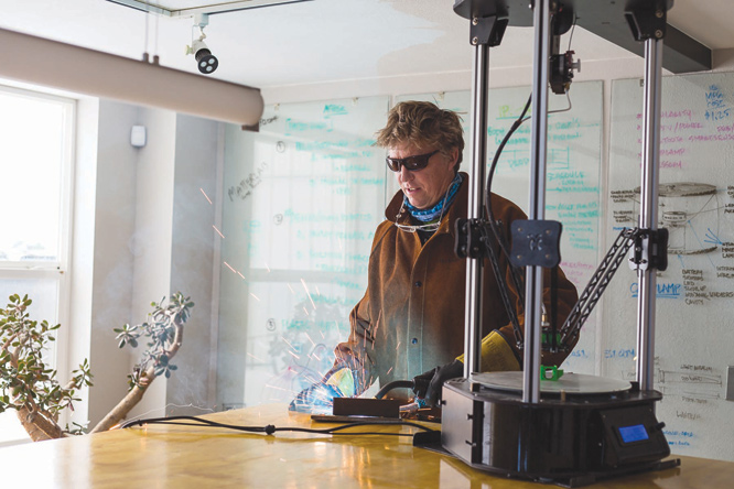 Jeff Scott sketches, welds, and 3D prints, all in his space at 4th and Belleview.   photo by Lydia Stern
