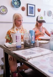 ARTS AND CRAFTS: The Art Studio on Elk hosted Father's Day paint your own pottery on Sunday.     Photo by Petar Dopchev.