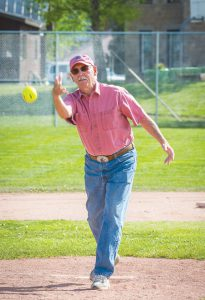 CEREMONIAL PITCH: Interim town manager Bill Crank threw the ceremonial pitch to officially announce the start of this year's softball season on Wednesday, June 8 at Gothic Field. photo by Lydia Stern