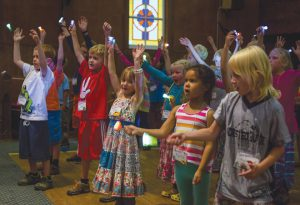 CAMP CONCERT:  Kids sang songs about Jesus at UCC during the culmination of an Oh Be Joyful Church summer camp.  photo by Lydia Stern