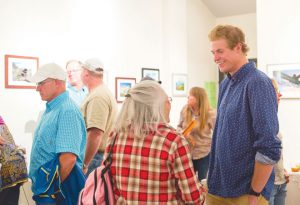 ARTIST RECEPTION: Nolan Blunck displayed his photography at the Piper Gallery on Monday, August 22. photo by Lydia Stern