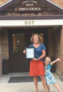 PASSING THE GAVEL: Outgoing BOZAR chairperson Liz Sawyer was honored by the Crested Butte Town Council last week for her almost 14 years of service on the board. Photo bomber and daughter Lexi Sawyer will enjoy the return of her mom on Tuesday nights.   courtesy photo